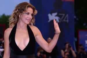 "Italian actress Claudia Gerini attends the premiere of the movie ""Ammore E Malavita"" presented in competition at the 74th Venice Film Festival on September 6, 2017 at Venice Lido.  / AFP PHOTO / Filippo MONTEFORTE"